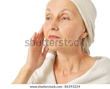middle aged woman, taking care of her skin - stock photo
