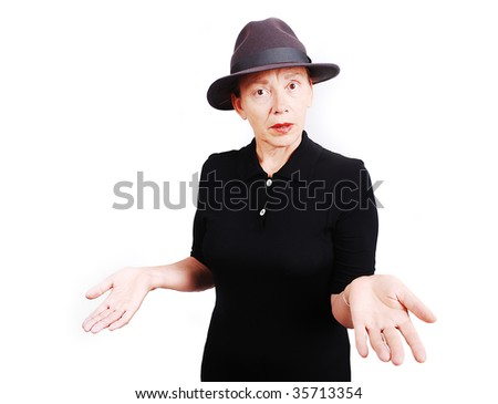 Middle aged woman wearing black dress and hat - stock photo