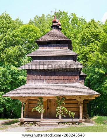 Middle ages orthodox woode church in outdoors museum of wooden architecture Shevchenkovskiy Gay in town Lvov (Lviv) in Ukraine. - stock photo