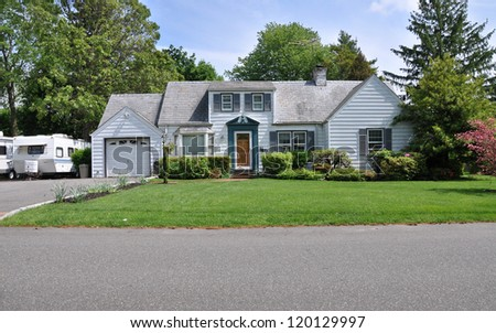 Middle Class Suburban Cape Cod style Home Front Yard - stock photo