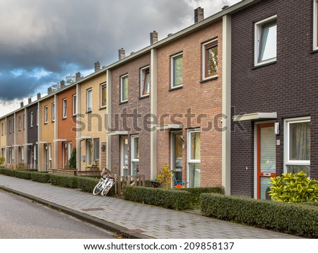 Middle Class Terraced Houses in Earthy Colors - stock photo