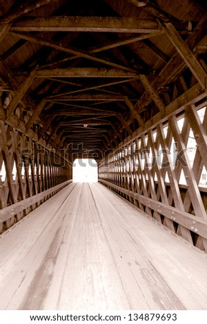Middle Covered Bridge in Woodstock, Vermont spans the Ottauquechee River. The town lattice bridge, built in 1969, is 139 feet long and carries vehicular as well as pedestrian traffic. - stock photo
