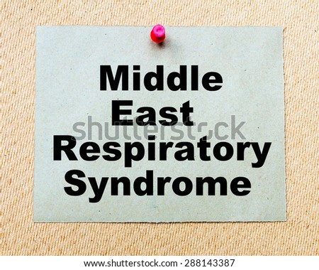 Middle East Respiratory Syndrome written on paper note pinned with red thumbtack on wooden board. Healthcare conceptual Image - stock photo