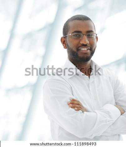 Middle Eastern Arabic black man at office building - stock photo