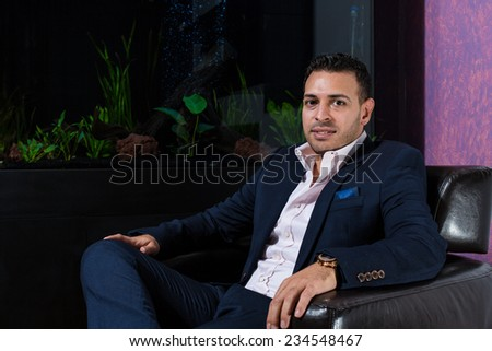 Middle Eastern businessman thinking - stock photo