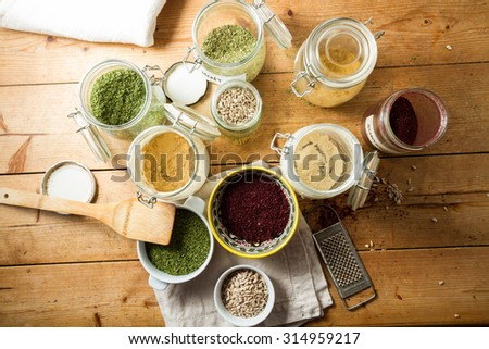 Middle Eastern cuisine: bowl of sumac, dried parsley, sunflower seeds, ginger and garlic in powder, cumin, turmeric, mint. - stock photo