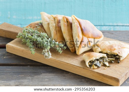 Middle eastern food fatayer stuffed in spinach - stock photo