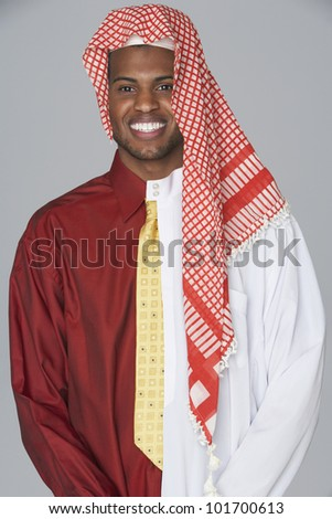 Middle Eastern man wearing traditional dress and business attire - stock photo