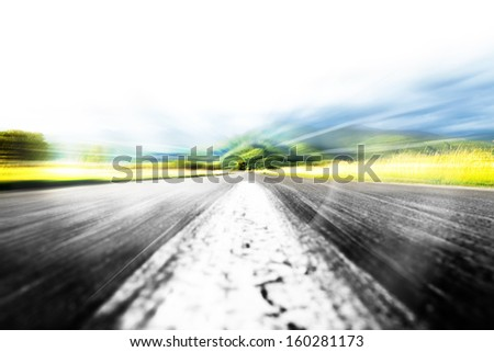 Middle of the road in the midddle of nature - stock photo