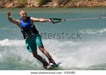 Middleage man wakeboarding - stock photo
