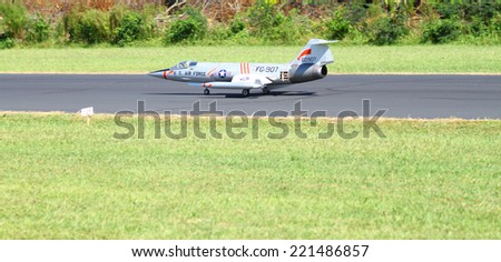 MIDDLESEX, VA - SEPTEMBER 27, 2014: A 1/4 scale USAF RC Jet on the runway at Hummel field airport runway in the wings wheels and keels annual show at the Hummel airfield airstrip in Middlesex VA - stock photo