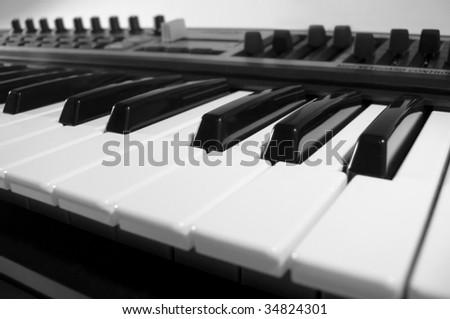 Midi keyboard close up. Piano roll. - stock photo