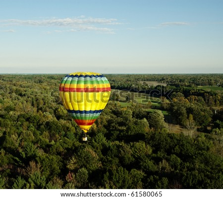MIDLAND, MICHIGAN-SEPTEMBER 17:  Hot air balloon participates in the 20th annual Balloon Festival fly on September 17, 2010 over Midland, MI countryside. This year 65 balloons participated. - stock photo