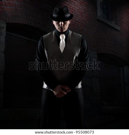 Midnight gangster in vintage look./Midnight killer - stock photo