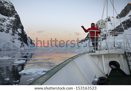 Midnight Sun - Adventure tourist and Russian Icebreaker in the Lamaire Channel in Antarctica. - stock photo