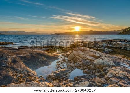 Midnight sun near Alta in Finnmark, Norway - stock photo