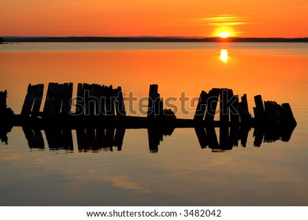 midnight sunset in the northern part of sweden - stock photo