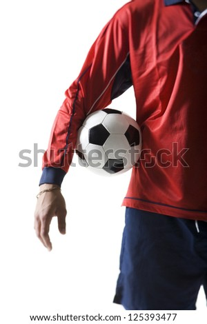 Midsection of a soccer player holding a ball - stock photo