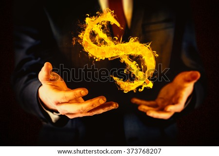 Midsection of businessman with arms out against dark background - stock photo