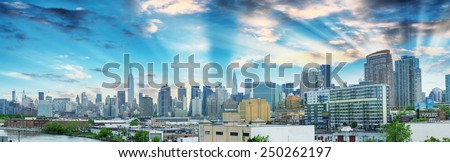 Midtown Manhattan eastern side panorama. Wonderful hi-res view from Brooklyn on a cloudy day. - stock photo
