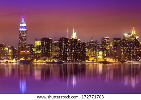 Midtown Manhattan, New York City skyline across East River after sunset - stock photo