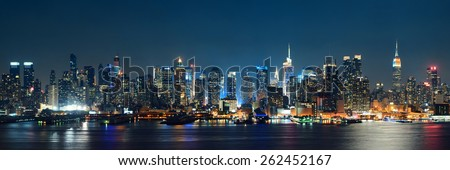 Midtown Manhattan skyline at dusk panorama over Hudson River - stock photo