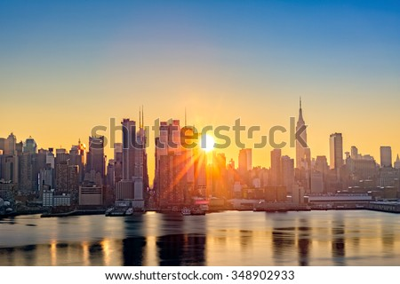 Midtown Manhattan skyline at sunrise, as viewed from Weehawken, along the 42nd street canyon - stock photo