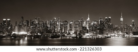 Midtown Manhattan skyline in black and white at dusk panorama over Hudson River - stock photo