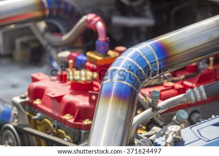 Mig welded seam on stainless steel pipe in racing car - stock photo