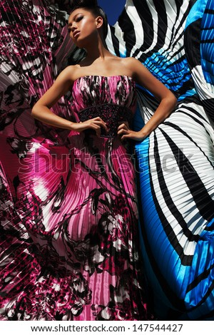 Mighty Colors. Colorful fashion model in beauty dress. - stock photo