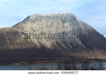 mighty mountain with blue fjord underneath at vollan, northern Norway - stock photo