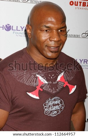 Mike Tyson at the DESIGNCARE 2007 Fundraiser to benefit those battling debilitating disease and life circumstances. Private Residence, Malibu, CA. 07-21-07 - stock photo