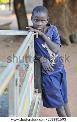 MIKUNI VILLAGE, ZAMBIA - APRIL 22, 2012: Unidentified boy from Mikuni Village, Zambia outside of Livingstone, Southern Zambia. - stock photo