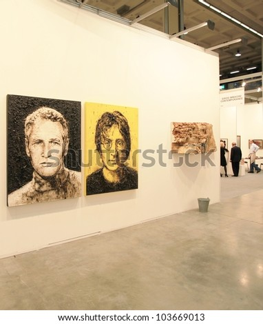 MILAN - APRIL 08: Paul Newmann and John Lennon represented at paintings galleries during MiArt, international exhibition of modern and contemporary art on April 08, 2011 in Milan, Italy - stock photo