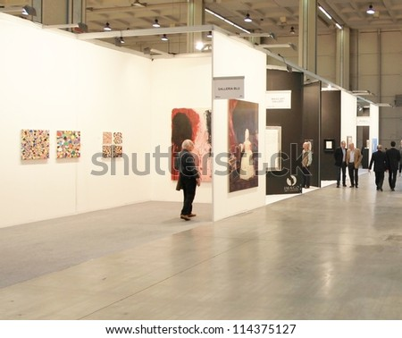 MILAN - APRIL 08: People look at paintings and sculpture galleries during MiArt, international exhibition of modern and contemporary art on April 08, 2011 in Milan, Italy. - stock photo