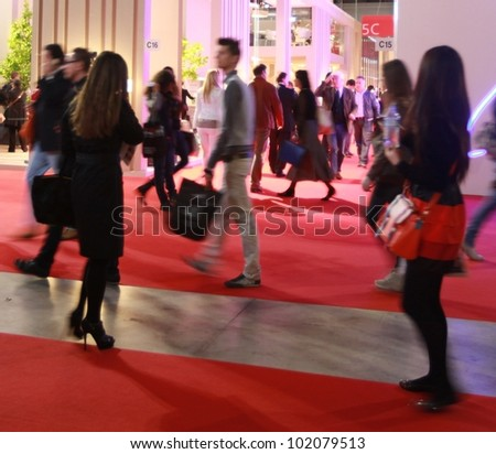 MILAN - APRIL 17: People visit architecture and interiors design pavillions at Salone del Mobile, international furnishing accessories exhibition on April 17, 2012 in Milan, Italy. - stock photo
