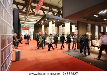 MILAN - APRIL 13: People visit interior design exhibition area at Salone del Mobile, international furnishing accessories exhibition on April 13, 2011 in Milan, Italy. - stock photo