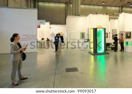 MILAN - APRIL 08: People visit paintings and sculpture work of arts galleries during MiArt, international exhibition of modern and contemporary art on April 08, 2011 in Milan, Italy. - stock photo