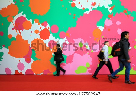 MILAN - APRIL 13: Visitors walking at Salone del Mobile, international furnishing accessories exhibition on April 13, 2011 in Milan, Italy. - stock photo