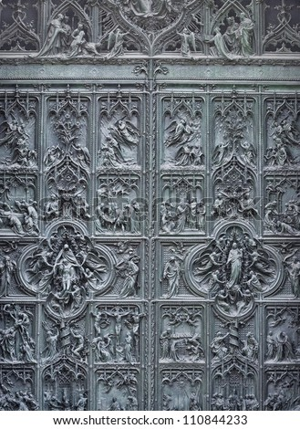Milan Cathedral door entrance, Italy - stock photo