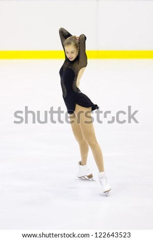 MILAN-DECEMBER 22: Carolina Kostner  perform in Italian Championships of Figure Skating 2012 on December 22 , 2012 in Milan, Italy - stock photo