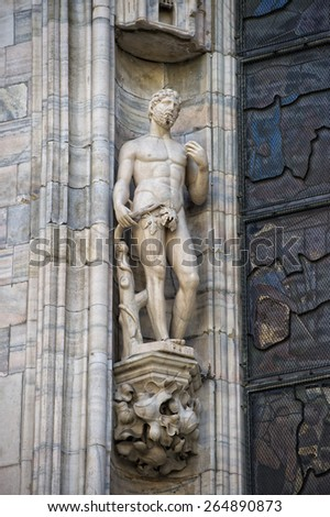 Milan Dome gothic Cathedral ADAM statue detail - stock photo