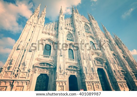 Milan Duomo, Italy. Famous landmark - the cathedral made of Candoglia marble. Filtered vintage color style. - stock photo