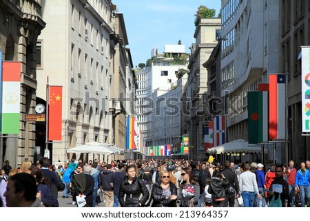 MILAN, ITALY - APRIL 20, 2014: A view of the crowd in Corso Vittorio Emanuele in the center of Milan, Italy. - stock photo