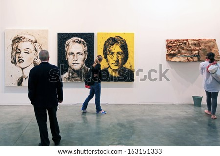 MILAN, ITALY - APRIL 08: People look at paintings galleries during MiArt, international exhibition of modern and contemporary art on April 08, 2011 in Milan, Italy  - stock photo