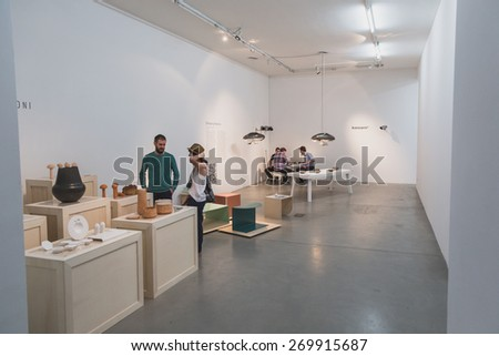 MILAN, ITALY - APRIL 15: People visit Fuorisalone at Ventura Lambrate space, location of important events during Milan Design Week on APRIL 15, 2015 in Milan. - stock photo