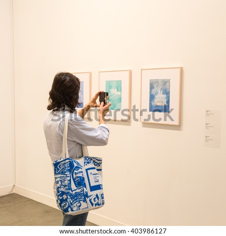 MILAN, ITALY - APRIL 8: People visit Miart, international exhibition of modern and contemporary art on APRIL 8, 2016 in Milan. - stock photo