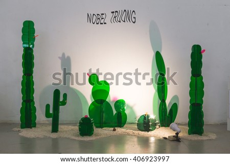 MILAN, ITALY - APRIL 16: Plastic cactus on display at Fuorisalone, set of events distributed in different areas of the town during Milan Design Week on APRIL 16, 2016 in Milan. - stock photo