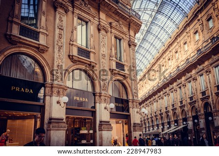 MILAN, ITALY - April 9, 2014: Prada Store in Galleria Vittorio Emanuele II shopping mall in Milan. Prada is an Italian luxury fashion house founded in 1913. Toned picture - stock photo