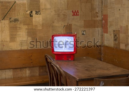 MILAN, ITALY-APRIL 17, 2015: vintage black and white television displayed during the Arts and Foods exhibition at the architecture, design and arts museum La Triennale, in Milan. - stock photo